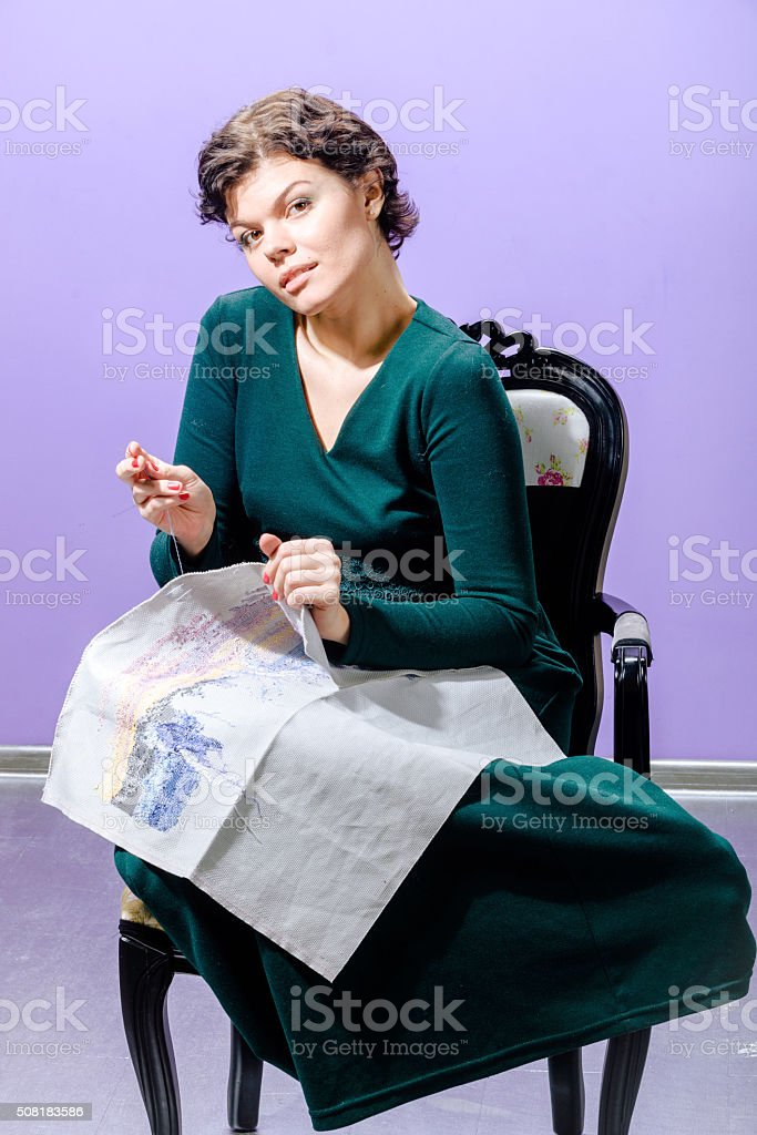 Girl with knitting work stock photo