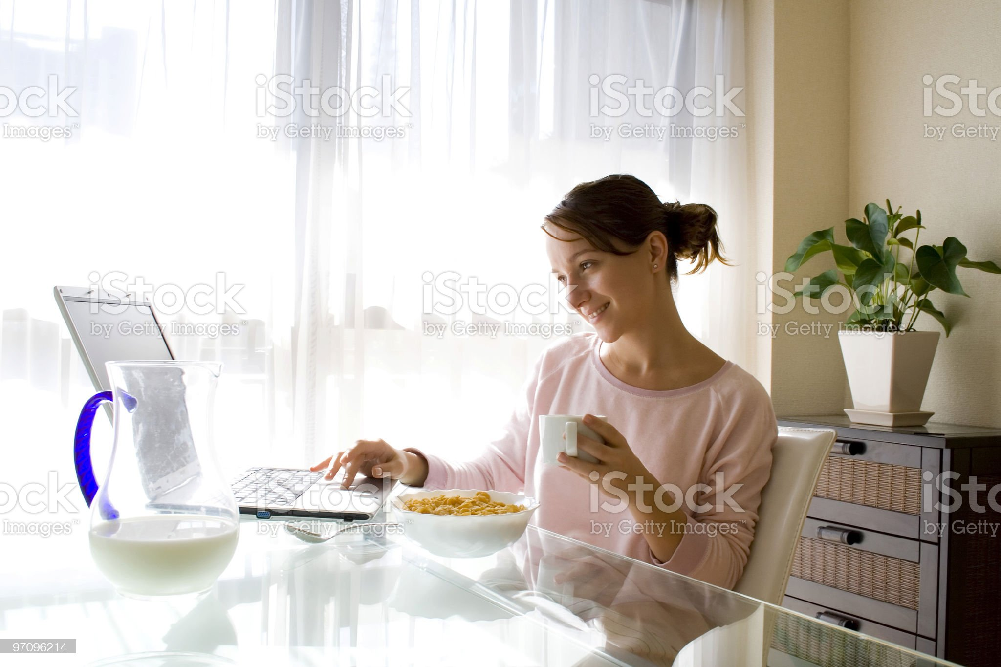 Girl with laptop at breakfast royalty-free stock photo