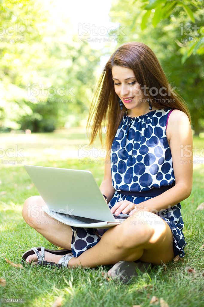 girl with laptop in the park royalty-free stock photo