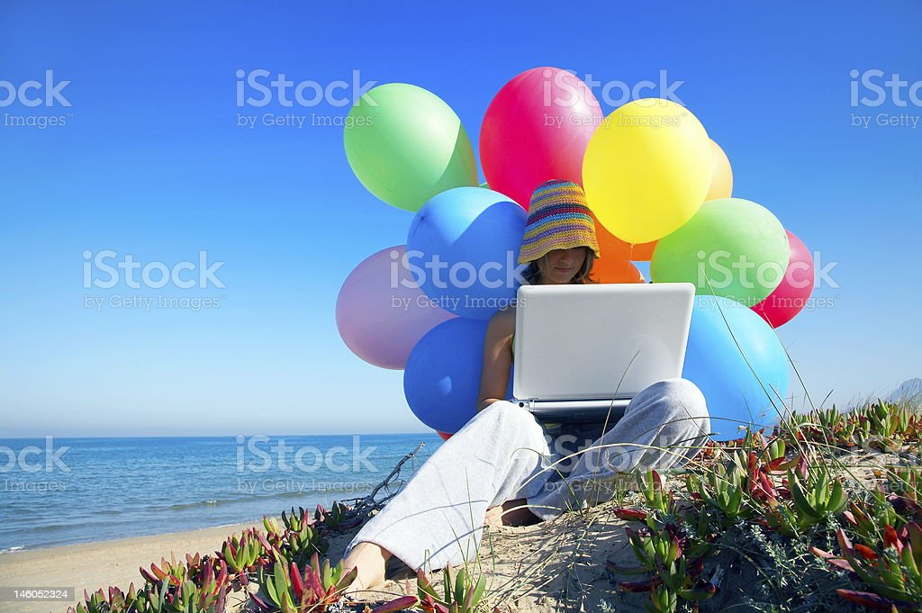 girl with laptop on the beach royalty-free stock photo