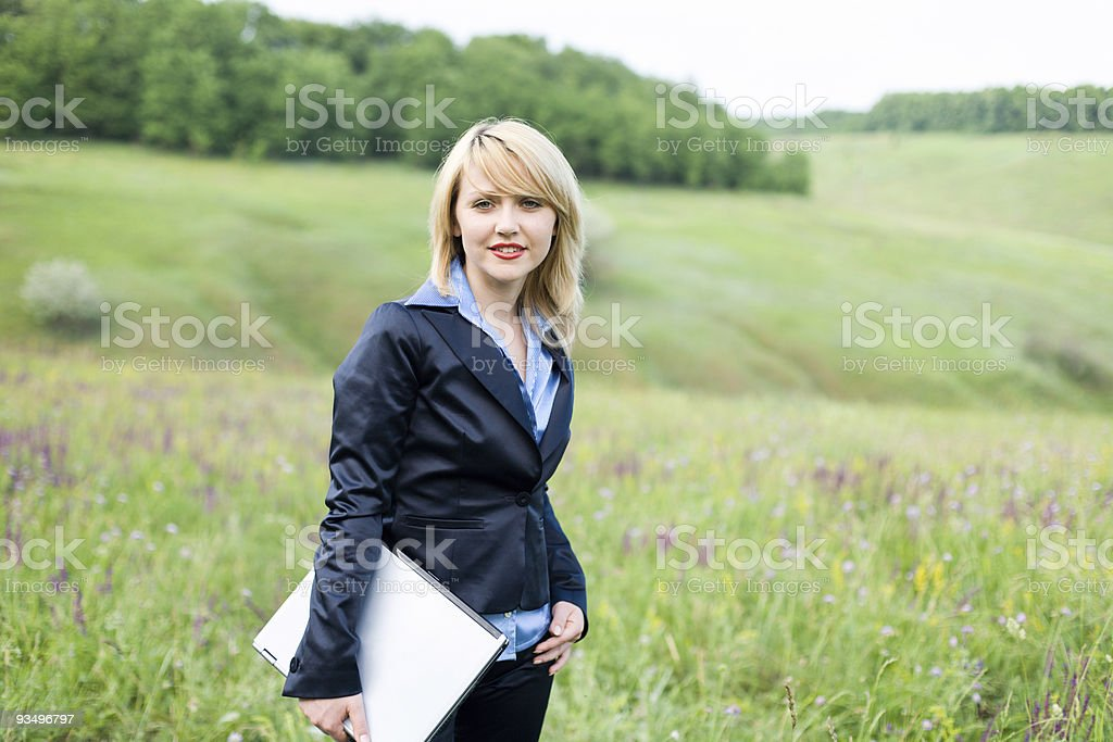 Girl with laptop stay on meadow royalty-free stock photo