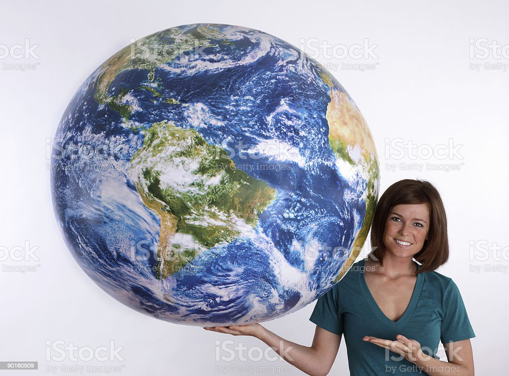 Girl with large globe royalty-free stock photo