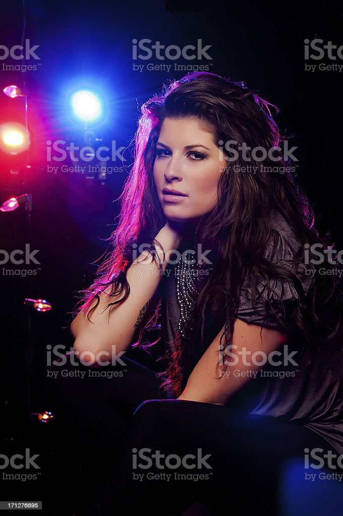 Girl with lights in background stock photo