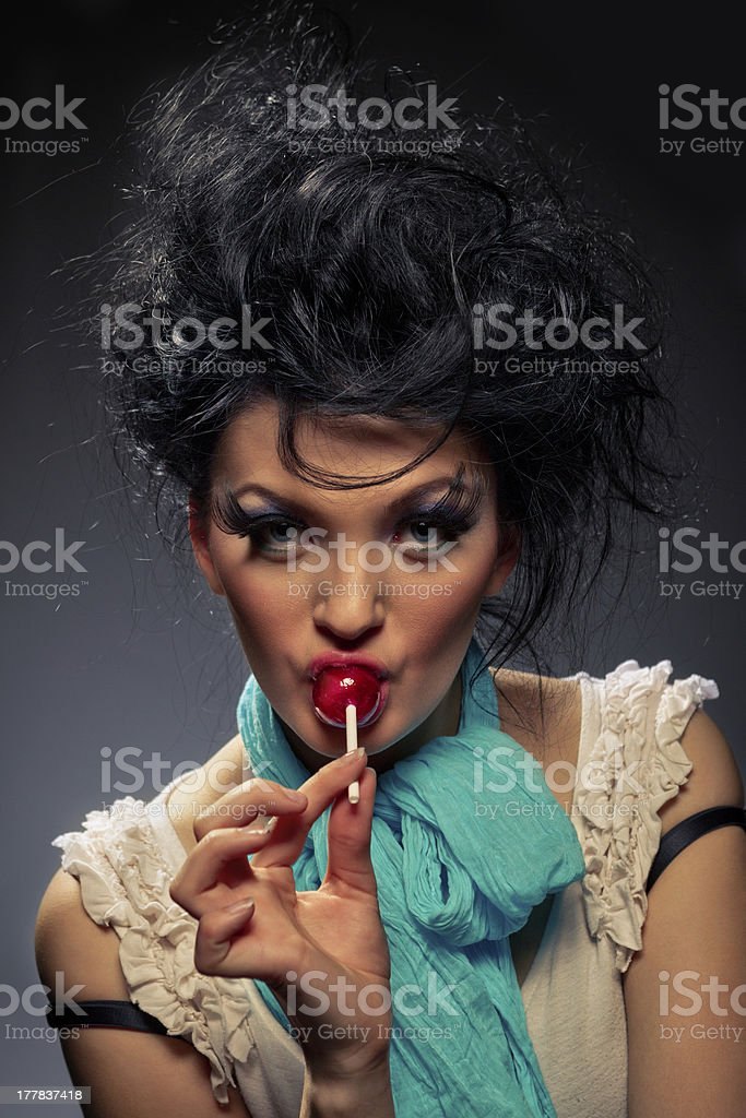 Girl with lollipops royalty-free stock photo