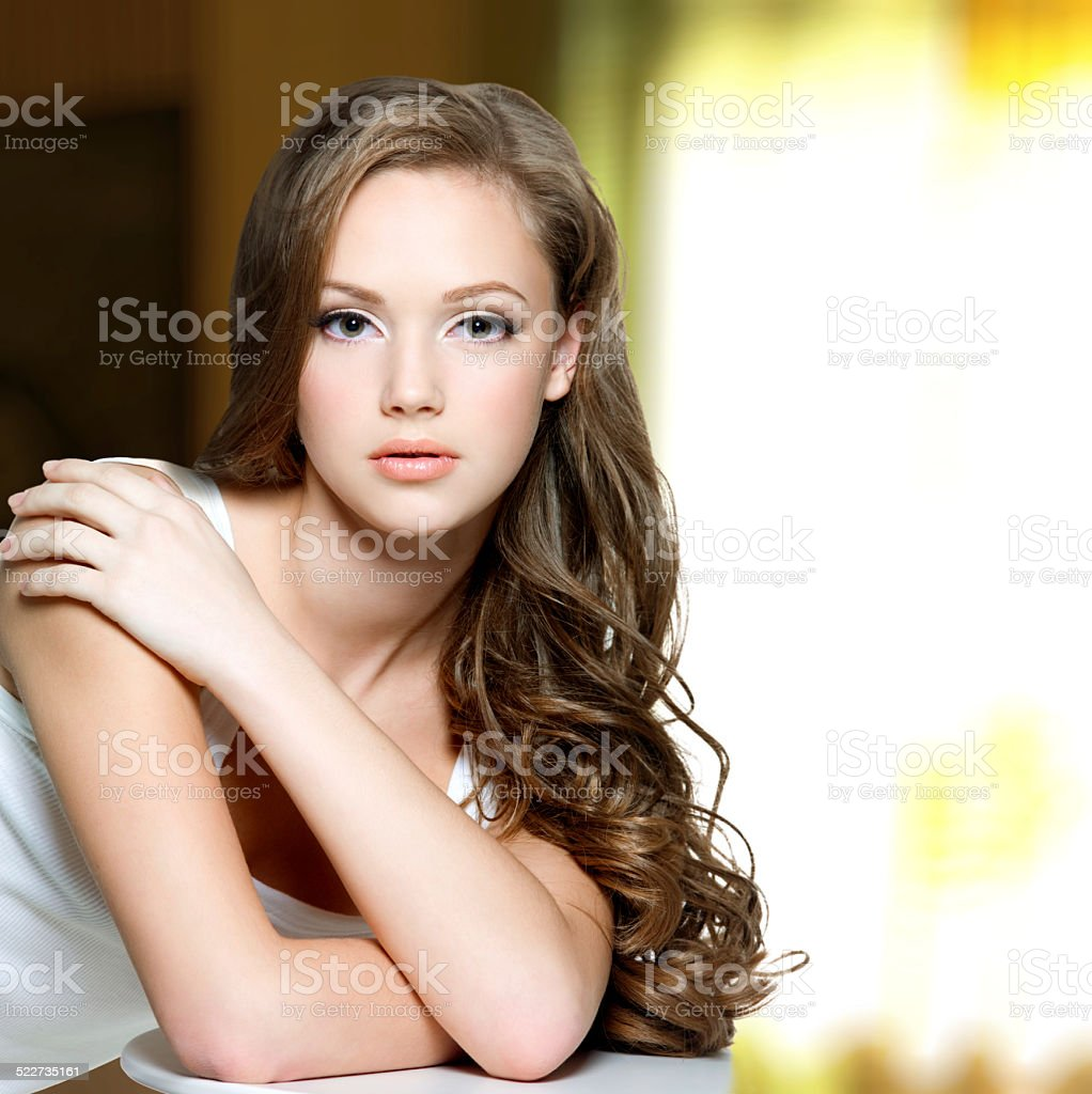 Girl with  long curly hairs stock photo