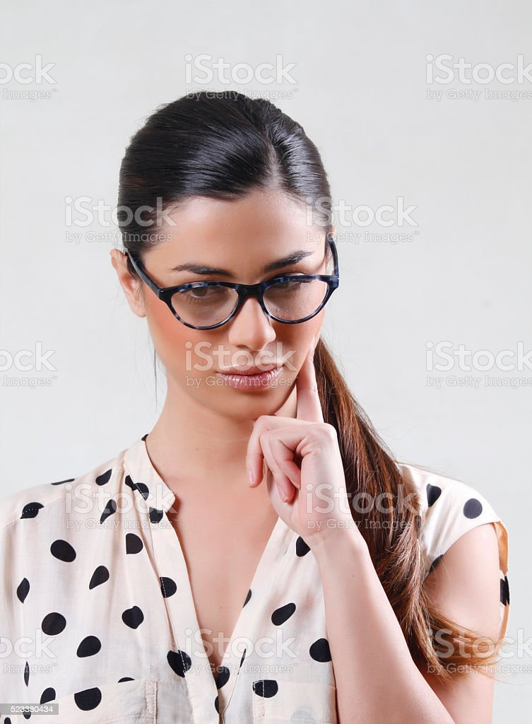 girl with  long hair and reading glasses thinking stock photo