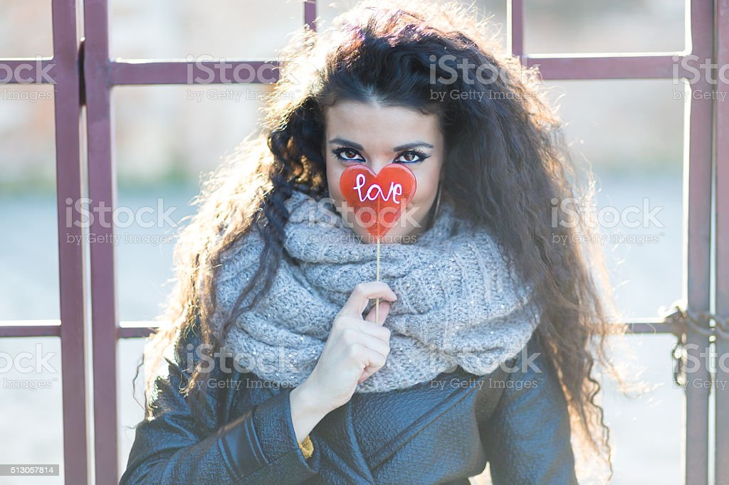 Girl with love lollipop stock photo