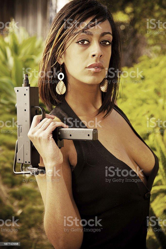 Girl with Machine Gun royalty-free stock photo