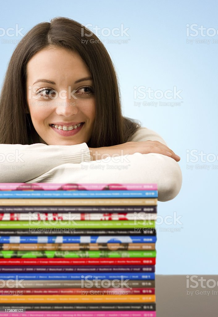 Girl with Magazines royalty-free stock photo