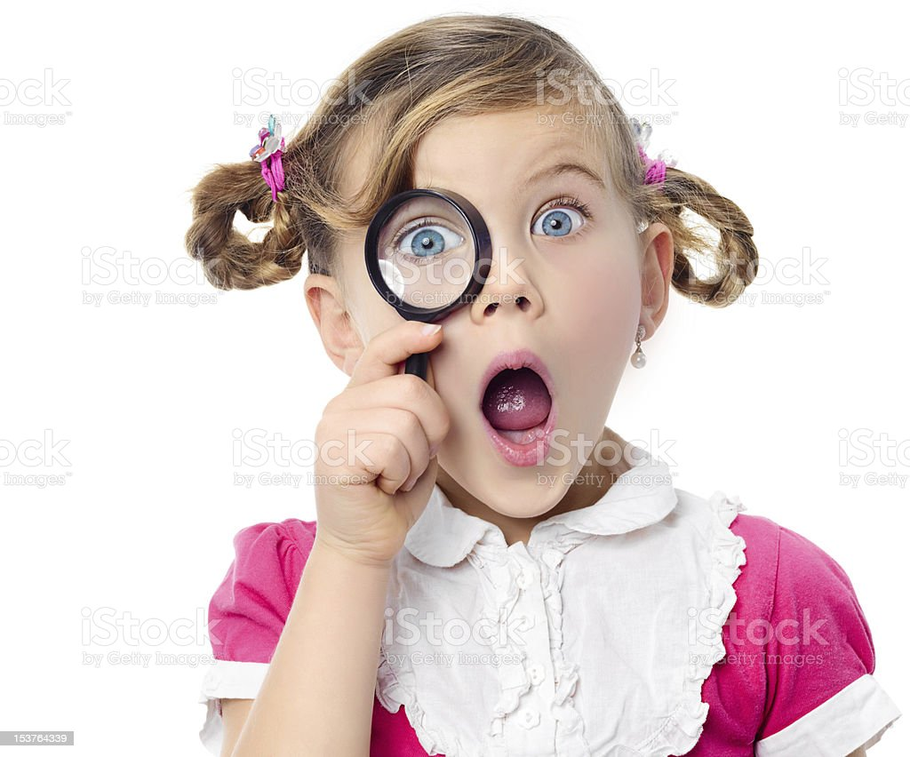 girl with magnifying glass royalty-free stock photo