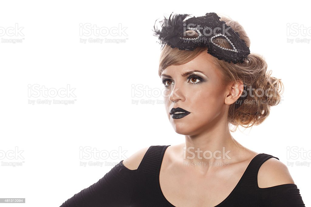 Girl with makeup and gothic masquerade mask. stock photo