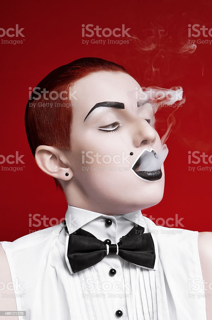 Girl with make-up smokes royalty-free stock photo