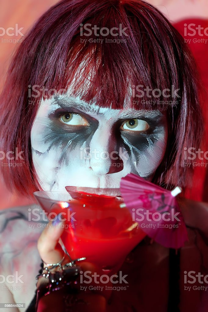 girl with makeup zombies bloody cocktail drink from glass stock photo