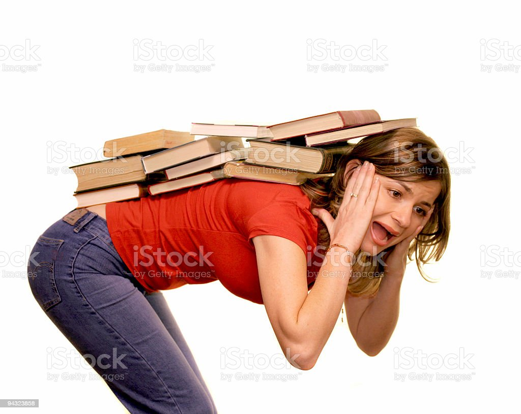 Girl with many books on her back stock photo