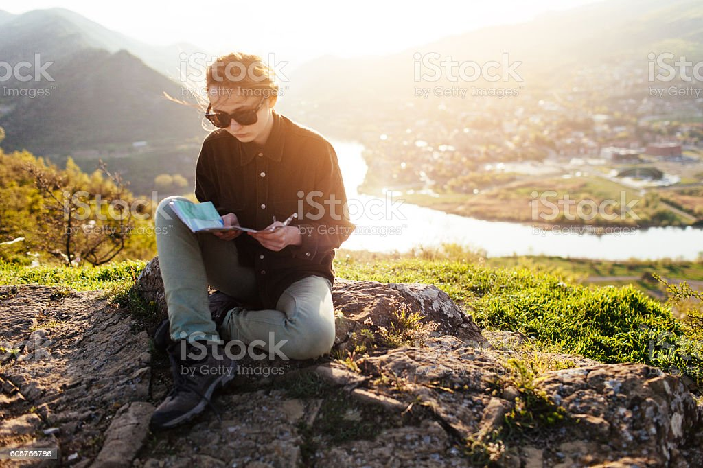 Girl with map on the background of town stock photo