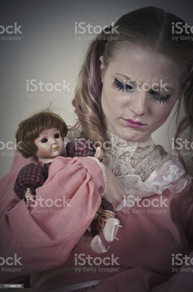 Girl With Mental Illness Holding a Doll royalty-free stock photo