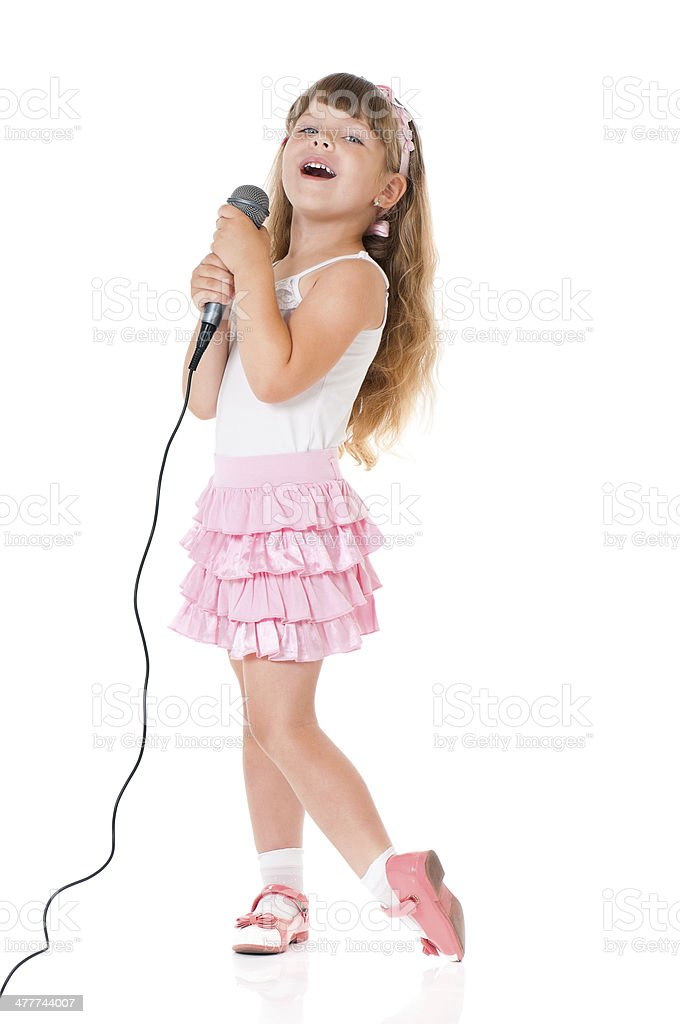 Girl with microphone royalty-free stock photo