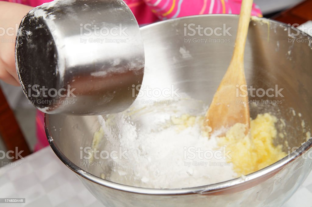 Girl with Mixing Bowl royalty-free stock photo