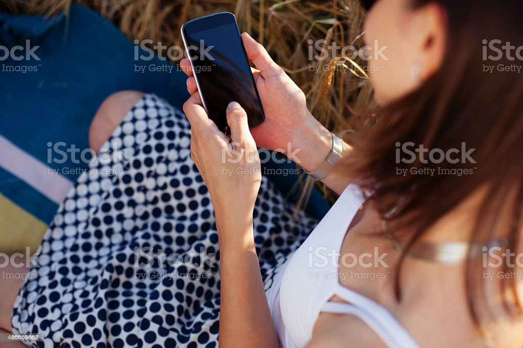 Girl with mobile phone in her hands stock photo