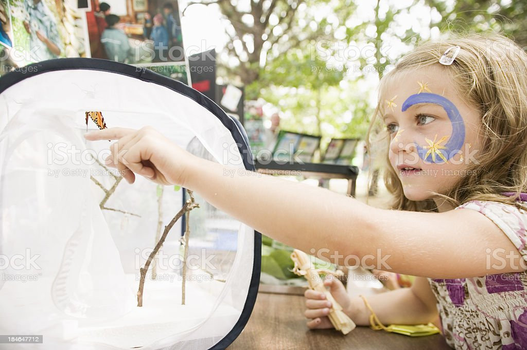 girl with Monarch Butterfly royalty-free stock photo