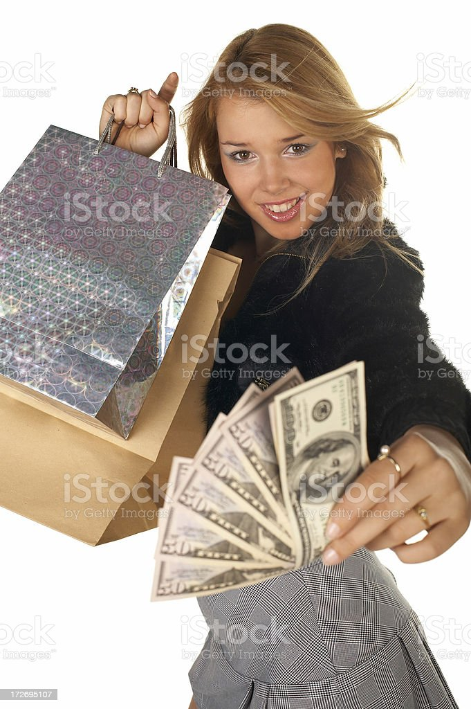 Girl With Money And Shopping Bag royalty-free stock photo