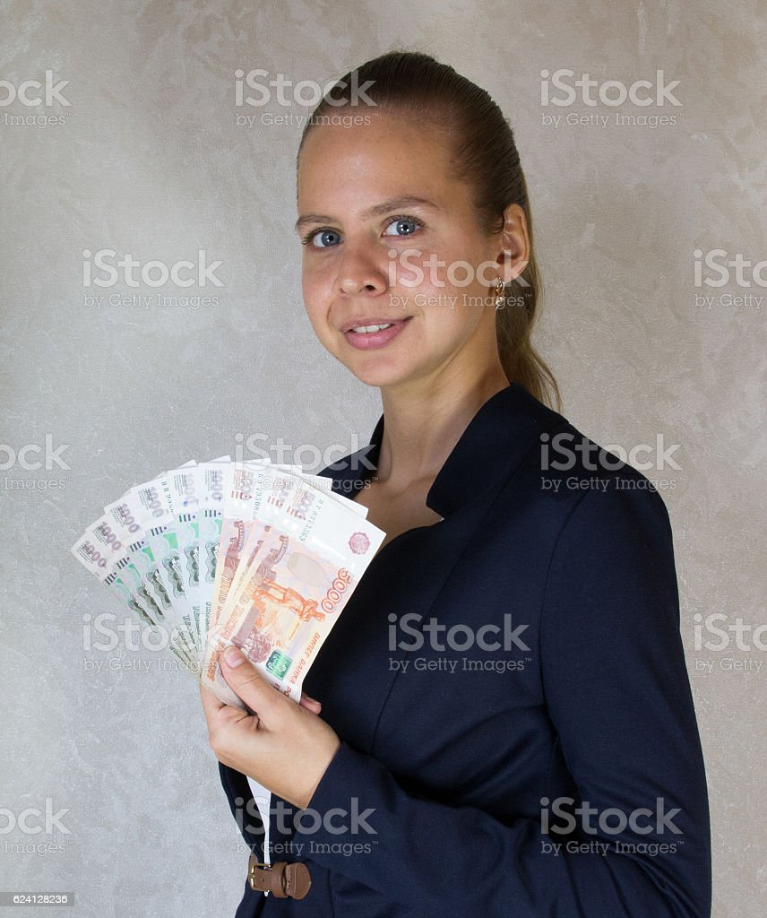 Girl with money in hand stock photo
