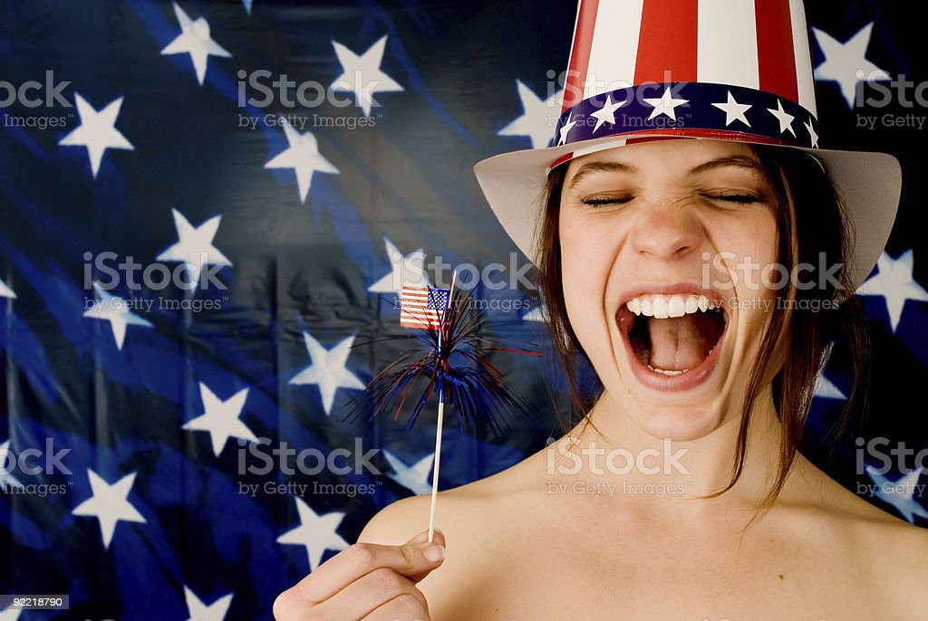 Girl with mouth wide open American flag hat and background royalty-free stock photo
