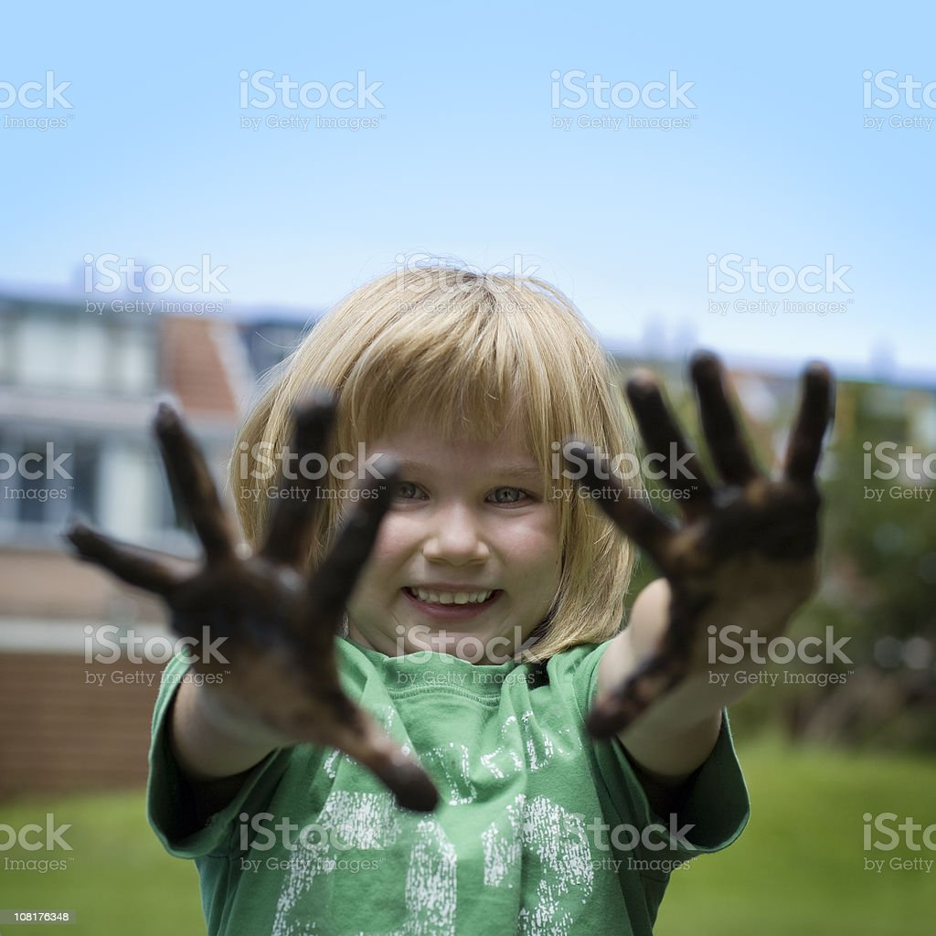 Girl with muddy hands royalty-free stock photo