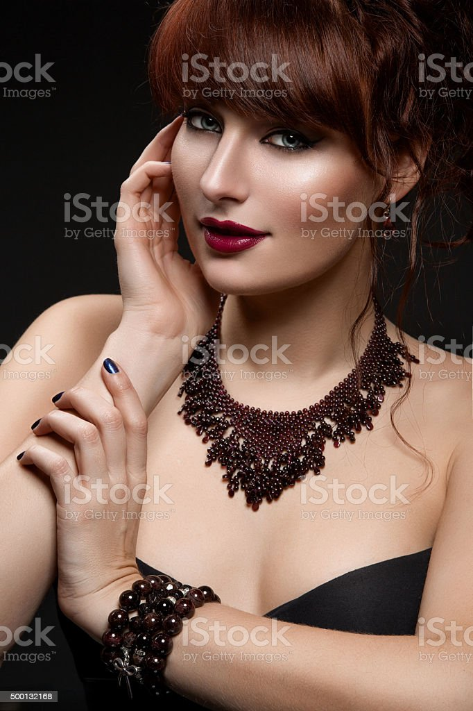 Girl with necklace and bracelets stock photo