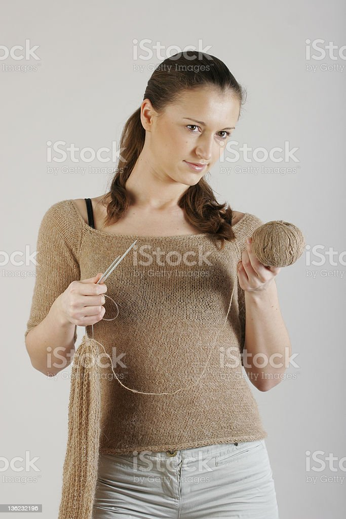 Girl with  needles and  clew royalty-free stock photo