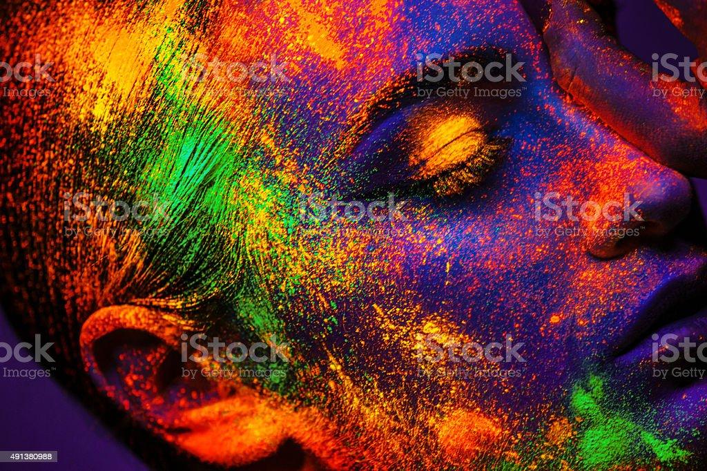 Girl with Neon Makeup powder stock photo