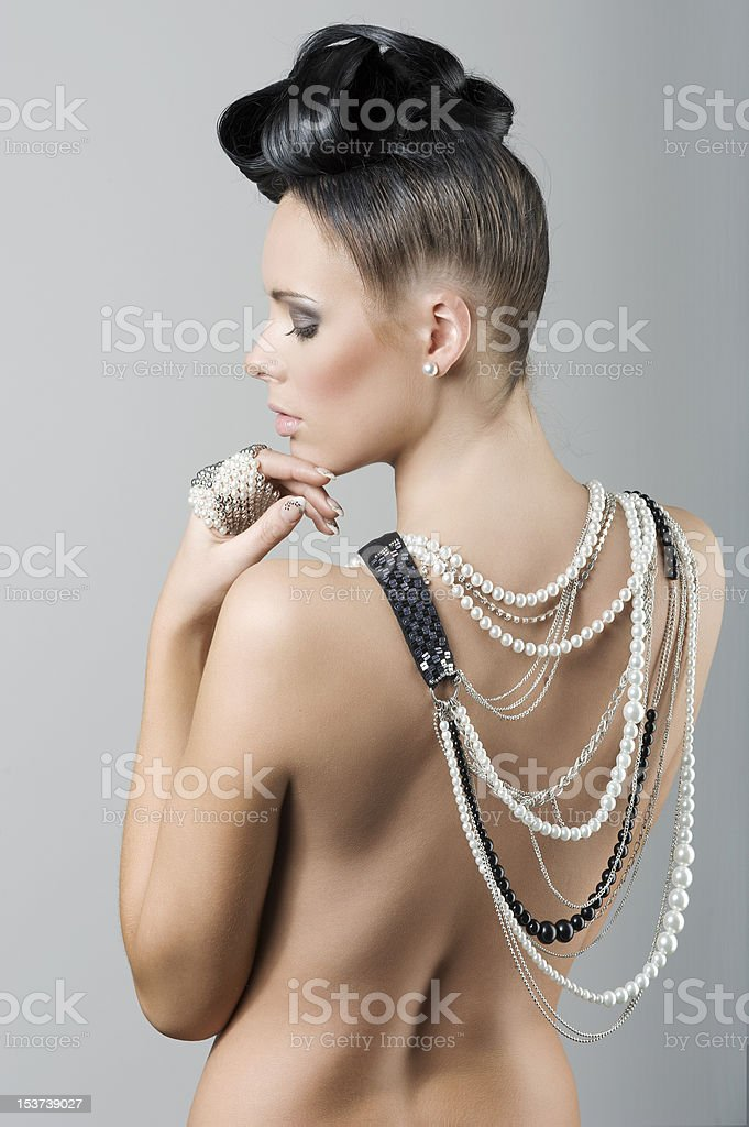 girl with nude back and hairstyle royalty-free stock photo