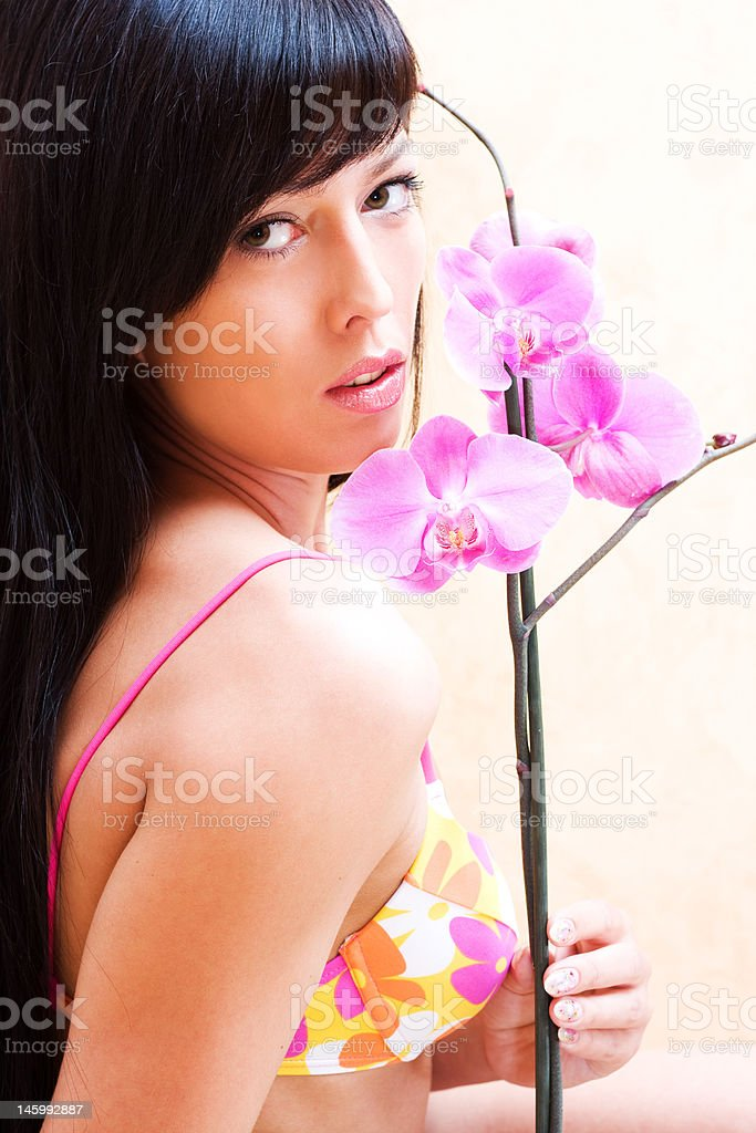 Girl with orchid royalty-free stock photo