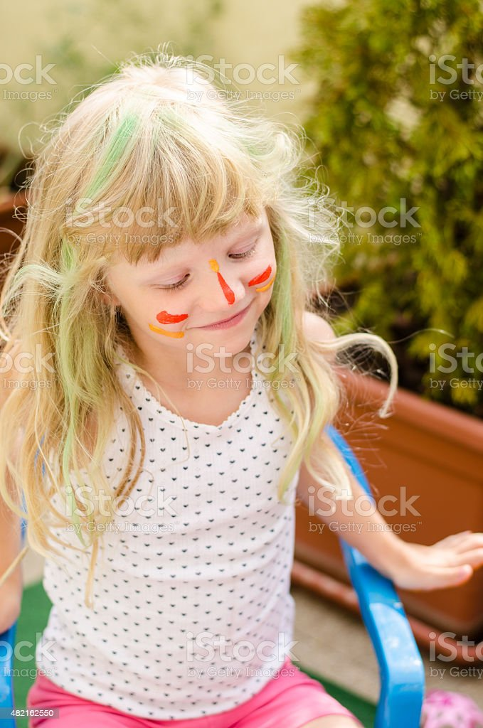 girl with painted face stock photo