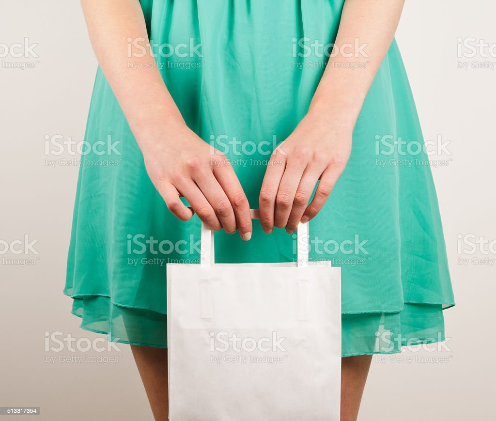 Girl with paper bags stock photo