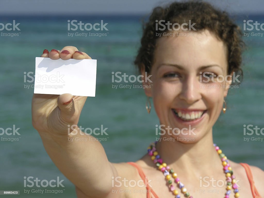 girl with paper for text on beach royalty-free stock photo
