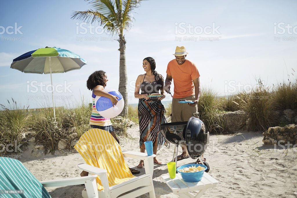 Girl With Parents Enjoying Beach Vacation royalty-free stock photo