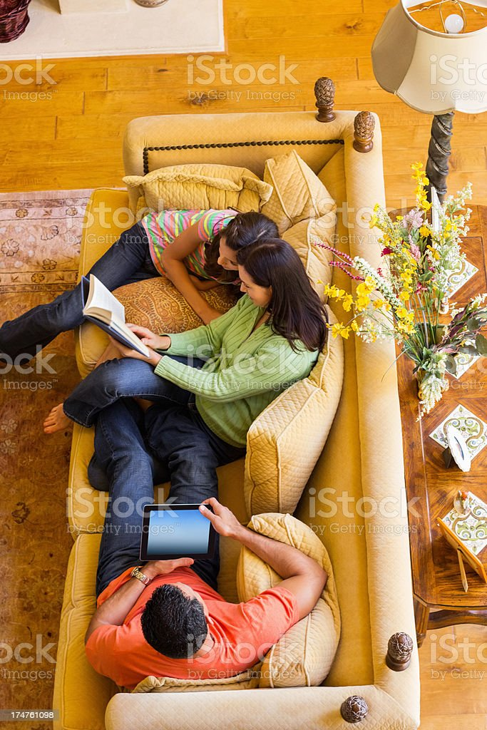 Girl With Parents On Sofa royalty-free stock photo