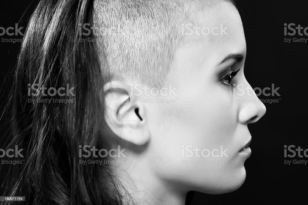 Girl with partially shaved head royalty-free stock photo