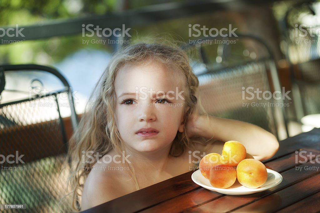 Girl with peaches royalty-free stock photo