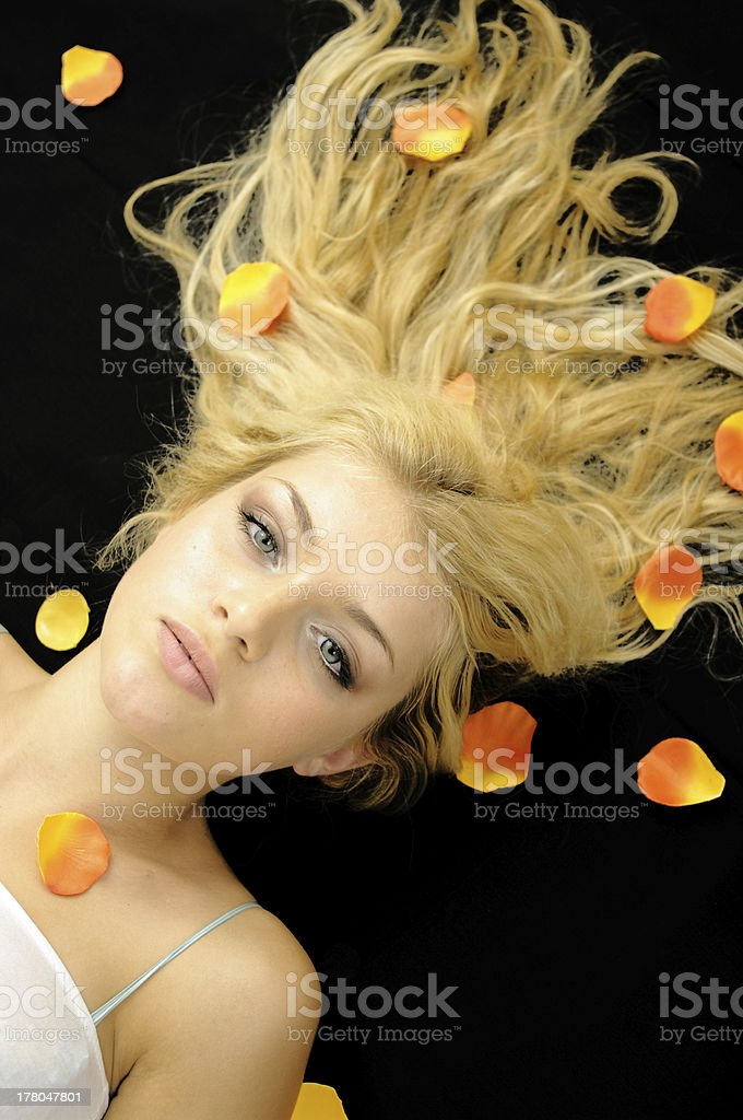 Girl with petals stock photo