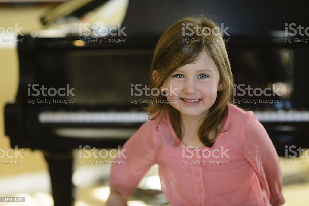Girl with Piano royalty-free stock photo