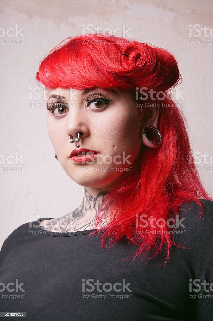 girl with piercings and tattoos stock photo