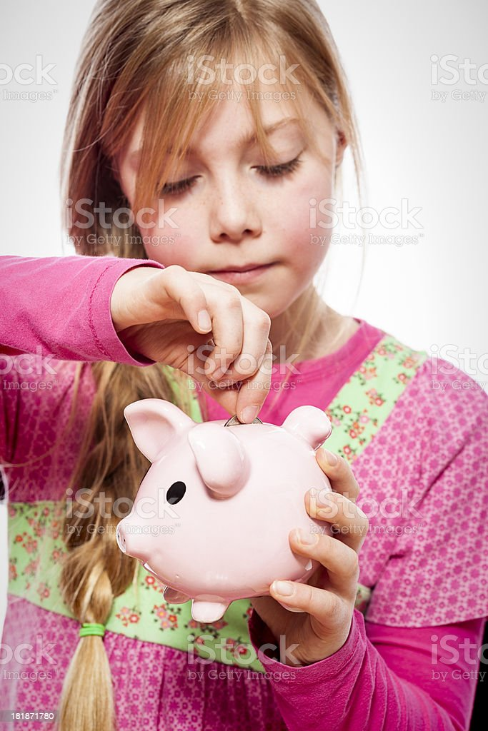 Girl with piggy bank royalty-free stock photo