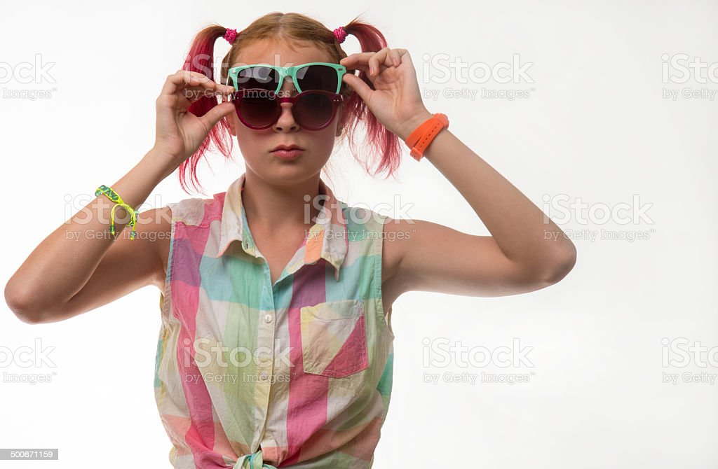 Girl with pigtails in glasses stock photo