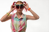 Girl with pigtails in glasses