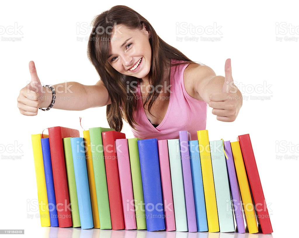 Girl with pile book showing thumb up. royalty-free stock photo