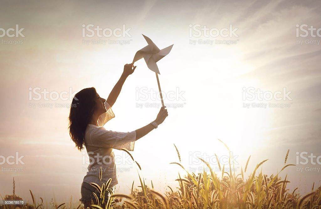 girl with pinwheel stock photo
