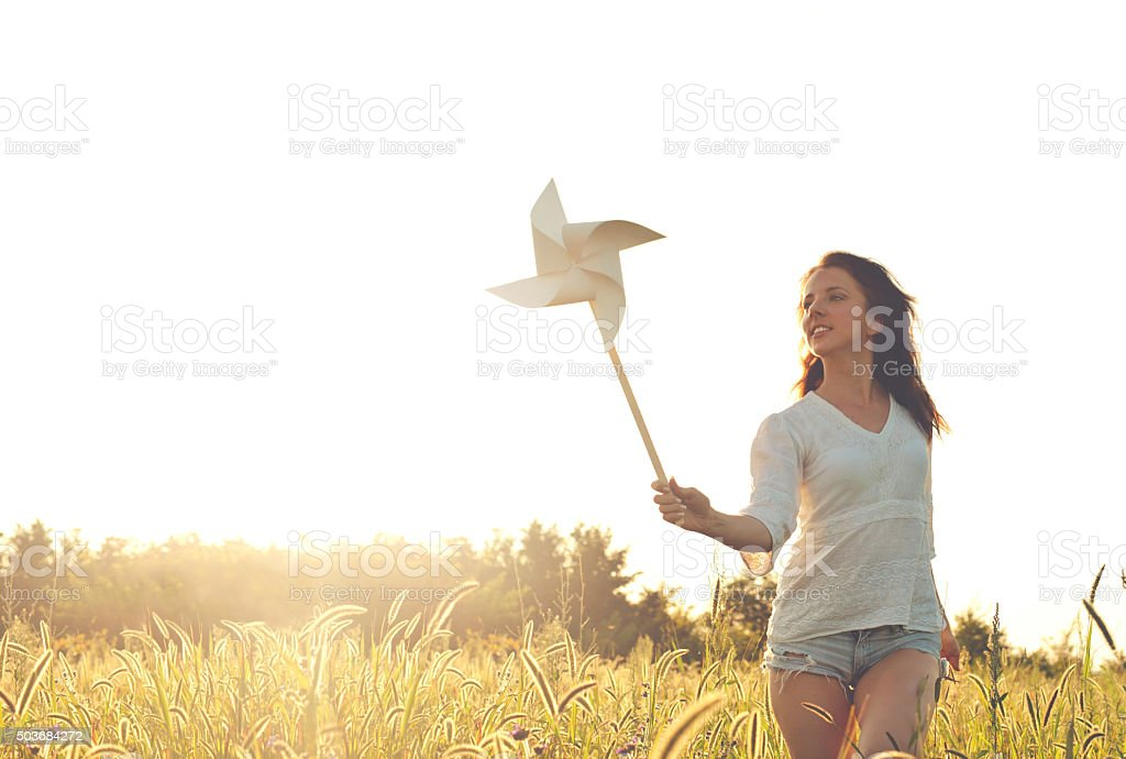 girl with pinwheel stock photo