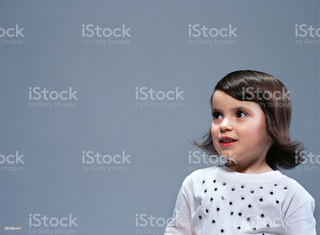 Girl with plastic eyes on her t-shirt royalty-free stock photo